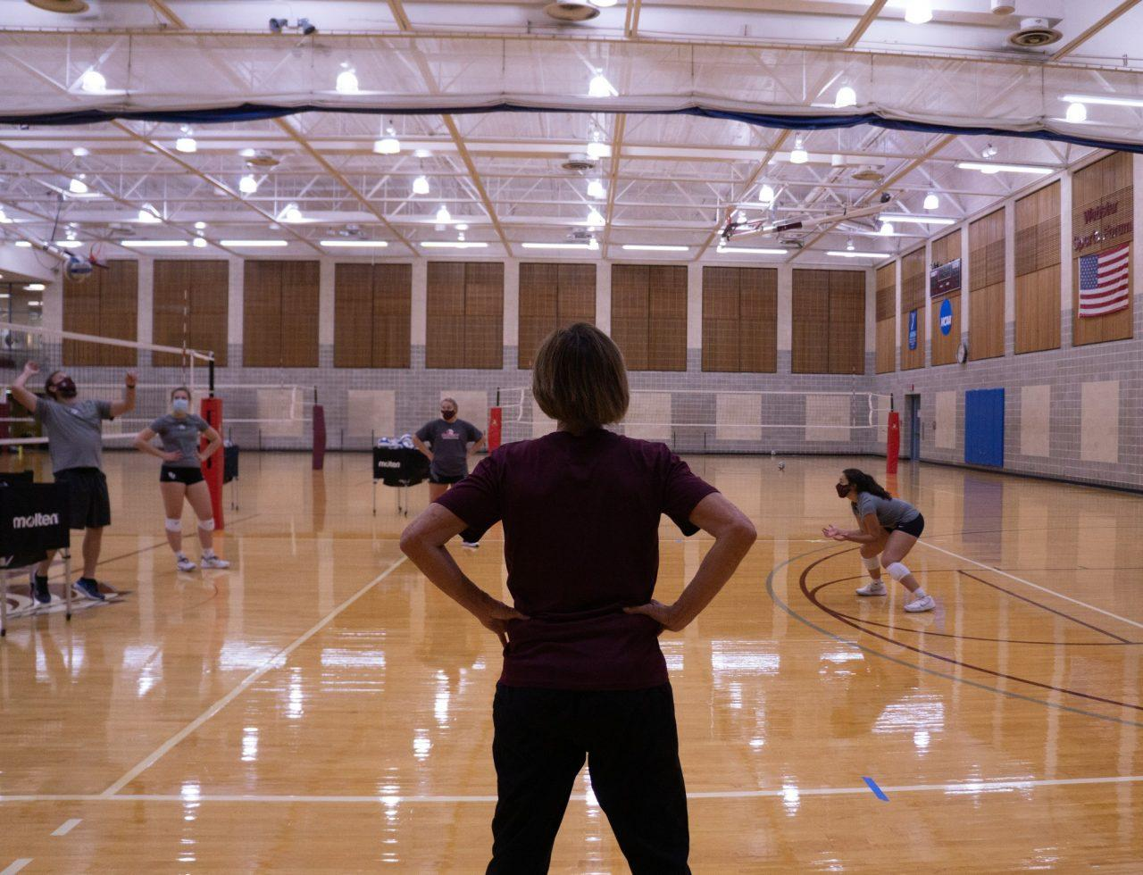 Head volleyball coach Julia Jenkins oversees a drill Photo credit: Kate Nuelle