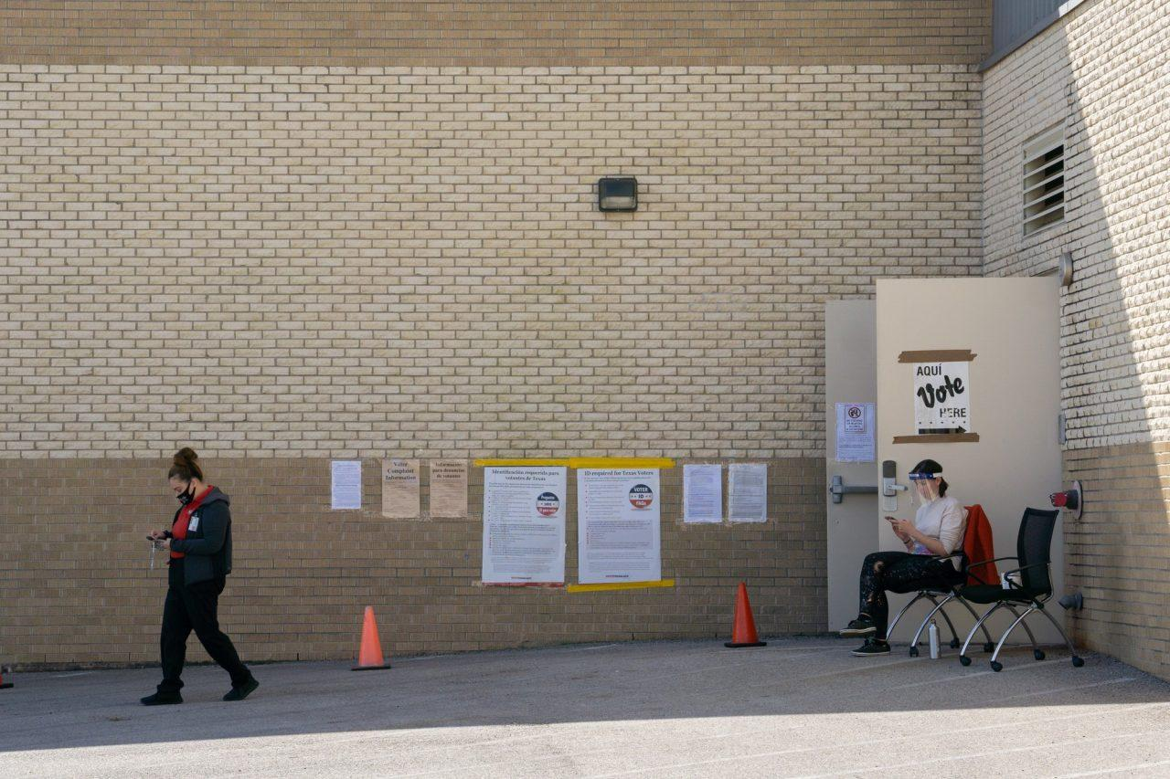 Carmen Mercado leaves Alamo Stadium after voting as poll worker Amy Riggle, class of '09, waits outside. Photo credit: Kate Nuelle