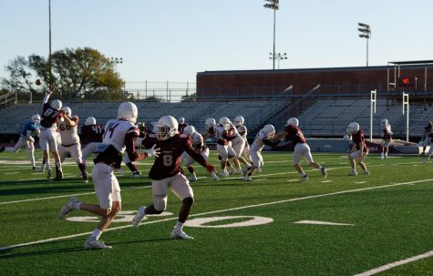 The football team practices on the field in the fall. Sports will return this spring while classes remain virtual until at least Feb. 8.