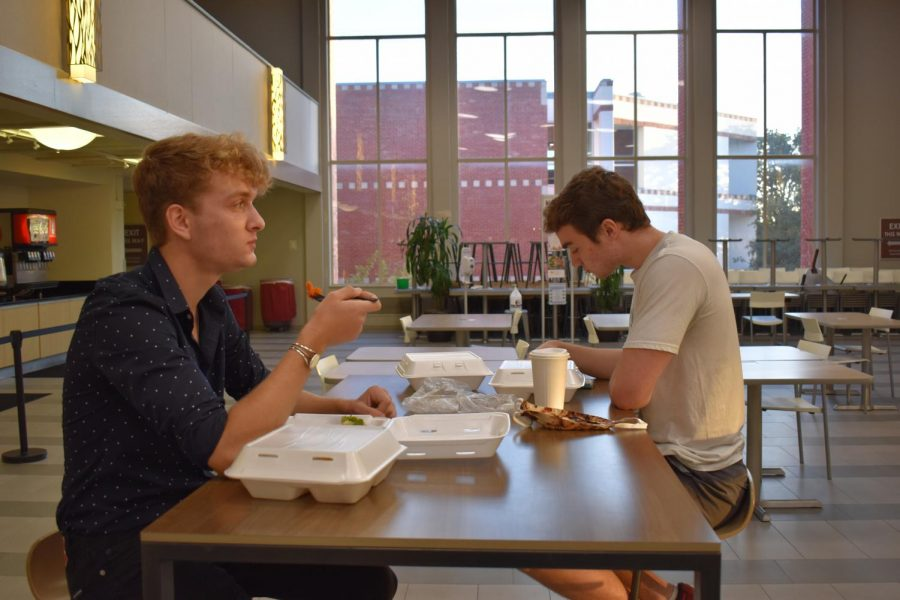First-years John Hawes and Sean Mitchell eating dinner at Mabee Dining hall, an Aramark dining service.