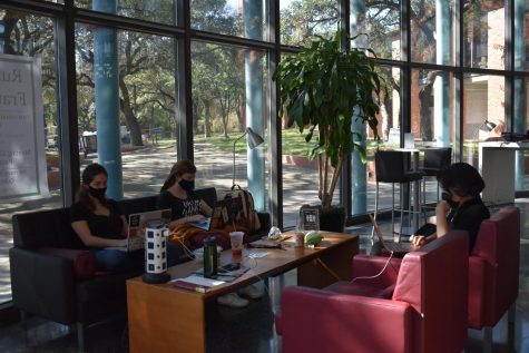 Maria Zaharatos, Taylor Condron, and Wren Ramos studying in Coates student center