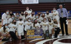 Cameron Hill and his women's basketball team pose with the SCAC trophy. This is Trinity's seventh SCAC Women's Basketball title. Photo provided by Trinity Athletics