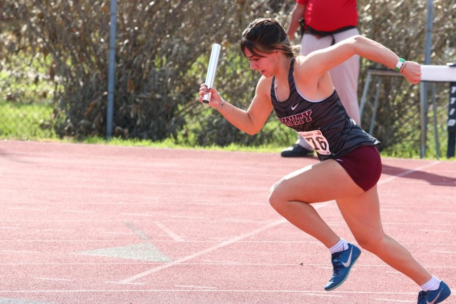 Sophomore Avery Puig runs with a baton in hand. Puig earned the title of SCAC Women's Track Athlete of the Week for her performance at the Abilene Christian University Invitational.
