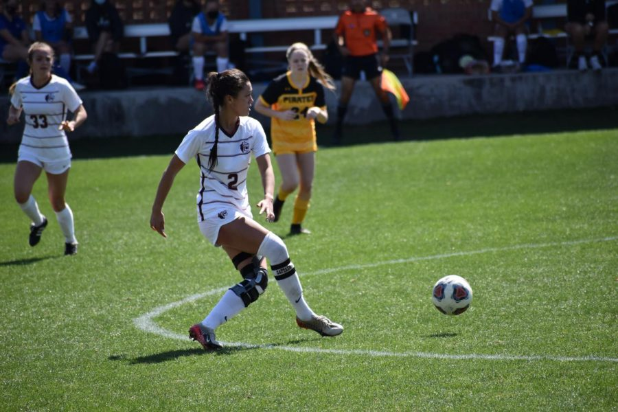 Lindsey Peng kicks the ball forward in a home match against Southwestern. Peng, the Tigers's only senior, was named the SCAC Tournament Defensive MVP for a second time in her career.