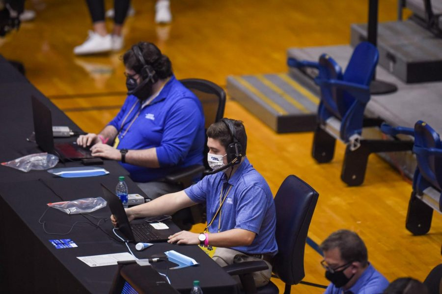 Trinity junior Jacob Stubbs and Assistant Director of Athletics Harrison LaLone input stats during a game in the NCAA Division I Women's Basketball Tournament. Stubbs does the same job for Trinity basketball games.