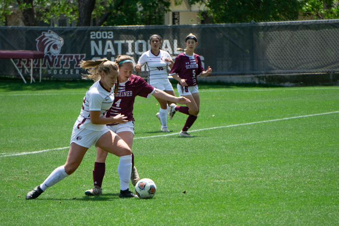 Sophomore forward Molly Sheridan battles for the ball against a Schreiner University defender. Sheridan scored two goals in Trinity