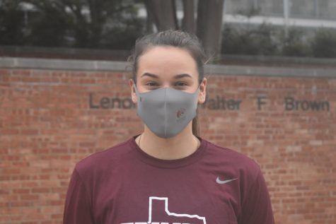 Senior volleyball player Avery Tuggle stands in front of the Bell Athletic Center at Trinity. Tuggle has decided to come back in the fall of 2021 for a fifth season with the Tigers.