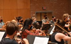 The orchestra's string players rehearse inside and within six feet of each other for the first time since the pandemic.